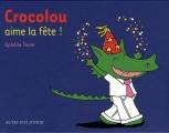 vignette de 'Crocolou<br /> Crocolou aime la fête ! (Texier, Ophélie)'