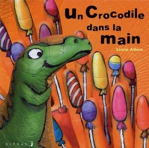 """Afficher """"Les histoires dans la mainUn crocodile dans la main"""""""